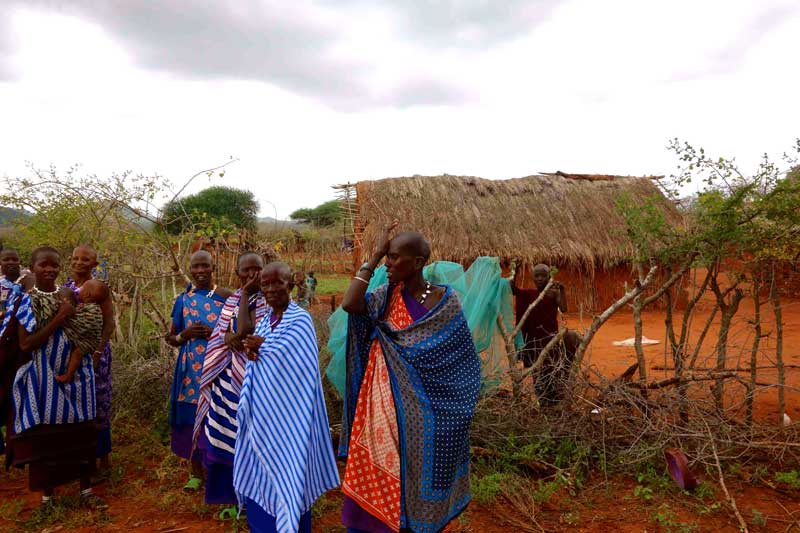 Village-women-from-Makokane.-Insecticide-treated-mosquito-nets-are-drying-on-the-fence